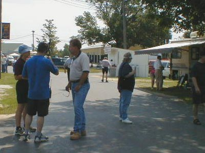 KC9ELV and N9QXZ converse with Jerry WB9Z, outside in the fleamarket